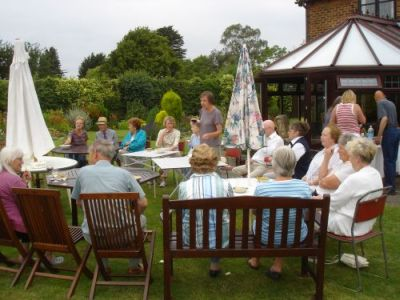 Members of the Help Holme Church Group relaxing after Open Gardens day and enjoying a chat over refreshments. - Photo Tony Foster